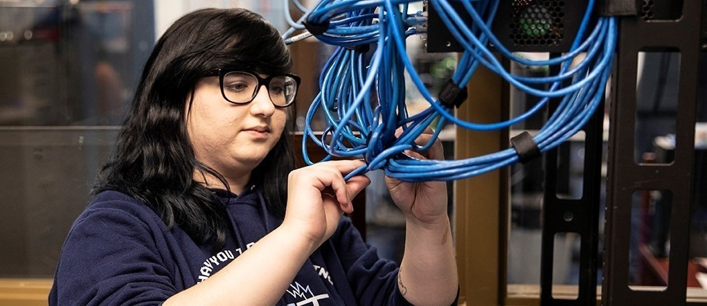 Information Technology Academy Student with cables