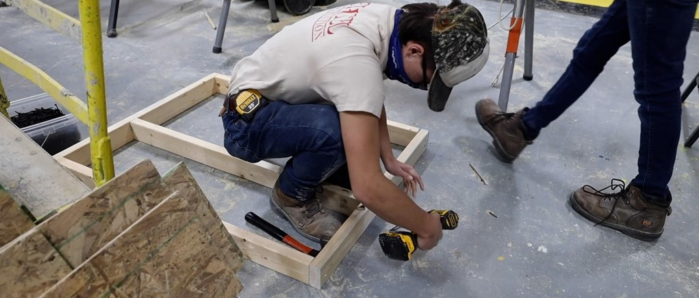 Construction Student using drill