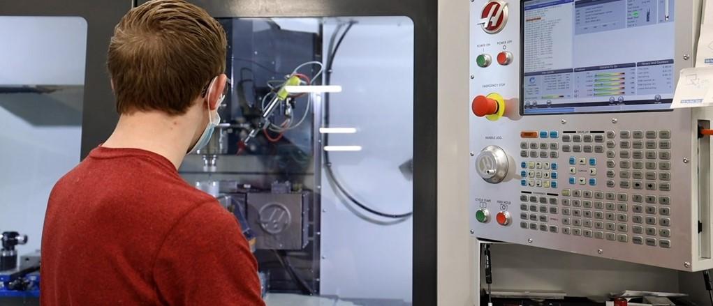 Precision Machining and Manufacturing student running cnc machine