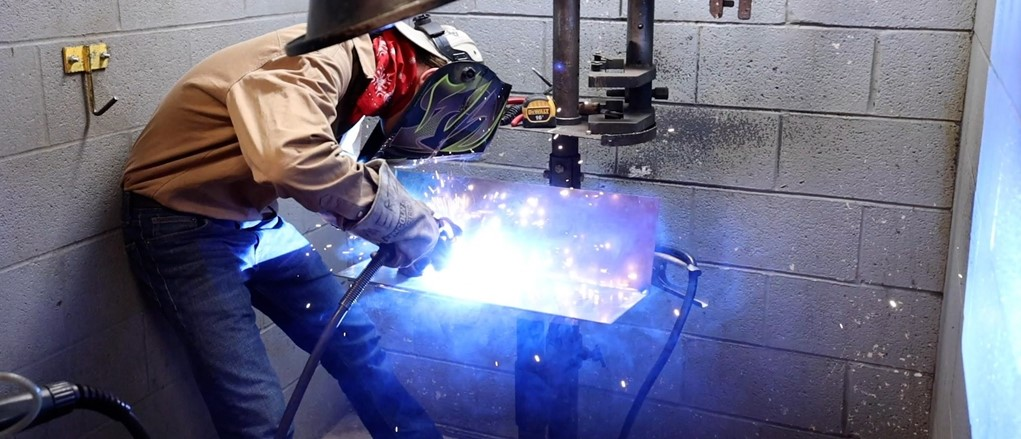 Welding and Fabrication student in booth welding