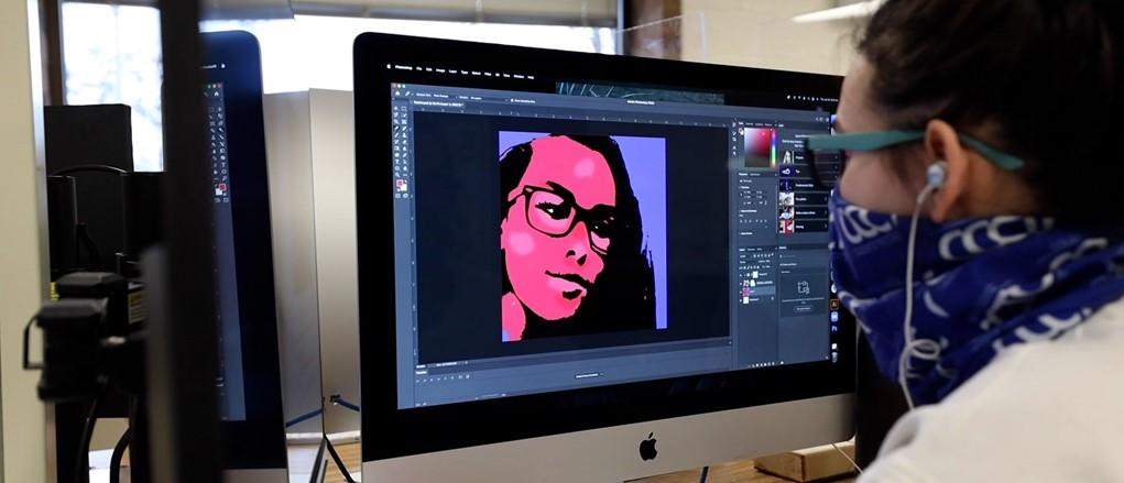 Interactive multimedia student working in graphic design
